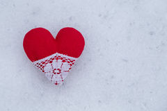 Red heart in a snow Royalty Free Stock Images