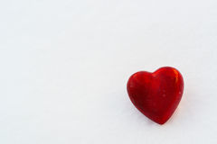 Red heart in the snow Stock Photos