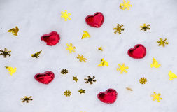 Red heart on snow Royalty Free Stock Image