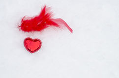 Red heart on snow Royalty Free Stock Photography