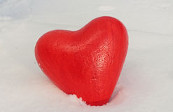 Red heart in snow Stock Photos