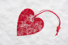 Red heart in snow Royalty Free Stock Images