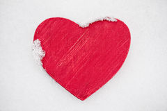 Red heart in snow Stock Image