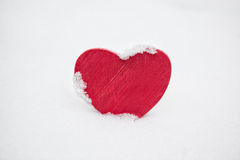 Red heart in snow Stock Images