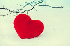 Red heart on the snow Stock Photo