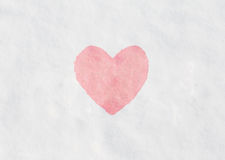 Red heart on snow Stock Image