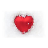 Red heart in the snow - white background Royalty Free Stock Images