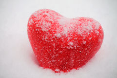 Red heart in snowfall Stock Photos