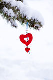 Red heart snowy christmas tree ornament  Royalty Free Stock Image