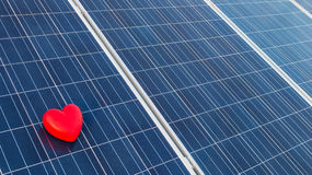 Red heart on a solar cell Royalty Free Stock Image