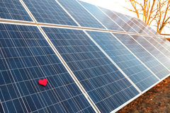 Red heart on a solar panel Stock Image