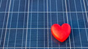 Red heart on a solar panel texture Royalty Free Stock Images