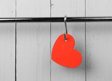 Red heart on stainless steel kitchen wall rack. Stock Image