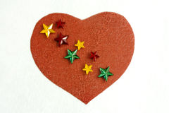 Paper heart with stars. A simple red heart on with plastic stars on it Royalty Free Stock Image