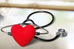Red heart and a stethoscope on backgrouund. Red heart stethoscope hear white background stock images