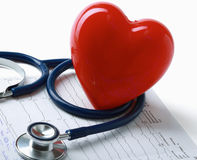 Red heart and a stethoscope on cardiagram Royalty Free Stock Images