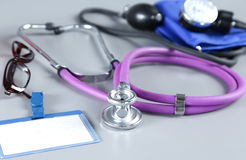 Red heart and a stethoscope on desc Stock Photos