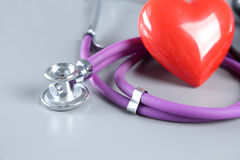 Red heart and a stethoscope on desc Royalty Free Stock Images