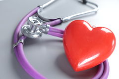 Red heart and a stethoscope on desc Stock Photo