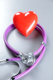 Red heart and a stethoscope on desc Royalty Free Stock Photos