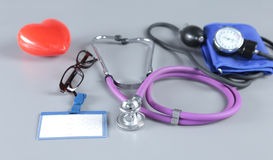 Red heart and a stethoscope on desc Stock Image