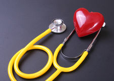 Red heart and a stethoscope on desc Stock Photography