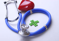 Red heart and a stethoscope on desc Stock Images