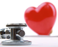 Red heart and a stethoscope on desk Stock Image