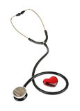 Red heart and a stethoscope, isolated on white background Stock Photo