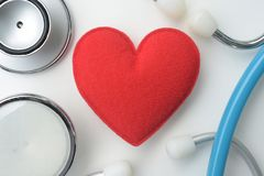 Red heart with stethoscope Stock Photos