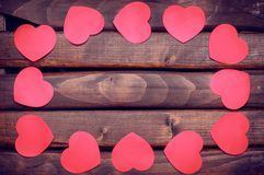 Red heart stickers on a wooden background Royalty Free Stock Photography