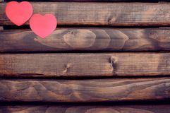 Red heart stickers on a wooden background Stock Photography