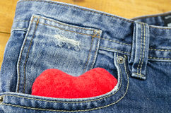 Red heart sticking out of a jeans front pocket Stock Photography