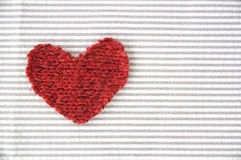 Red heart on striped Royalty Free Stock Photography