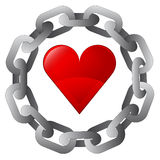 Red heart in strong steel circle chain  Royalty Free Stock Image