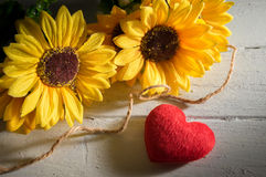 Red heart with sun flowers. Royalty Free Stock Photos