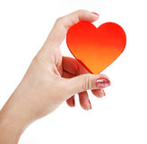 Red heart symbol in hand. On a white background stock images