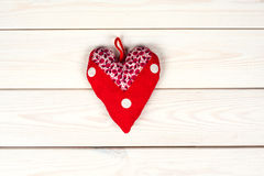 Red  heart symbol  hand made. On a wooden background Stock Photo