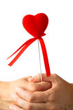 Red heart symbol in hands Stock Photo