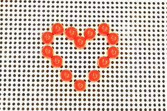 Red heart symbol on mosaic Royalty Free Stock Photos
