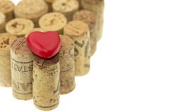Red heart symbol on wine corks form a heart shape image isolated on white Stock Photos