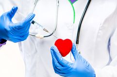 Red heart With Syringe Royalty Free Stock Photo
