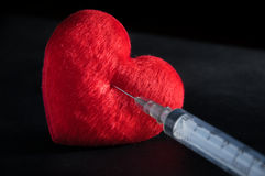 Red Heart with syringe Stock Image