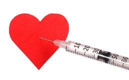Red heart with syringe Royalty Free Stock Images