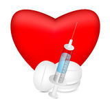 Red heart with a syringe and pills Stock Photos