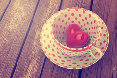 Red heart in tea cup Stock Images
