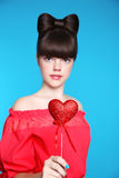 Red heart in teen girl hand. Brunette young model  with bow hair Stock Photos