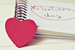 Red heart and text valentines day in a notebook, filtered Stock Image