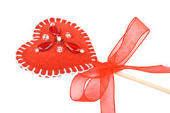 Red heart of the textiles with beads as a lollipop Stock Photos
