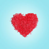 Red heart textured shape on blue background Stock Photo